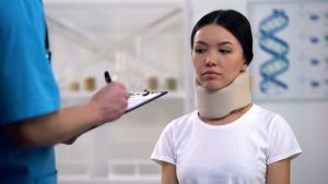 woman in neck brace at doctor
